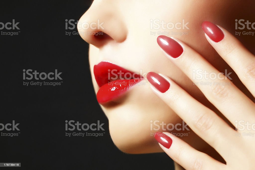 A woman with a manicured nails and beautiful makeup royalty-free stock photo
