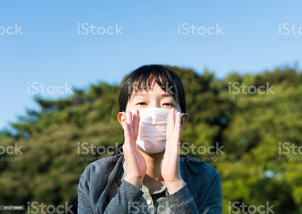 Woman with a mask calling stock photo