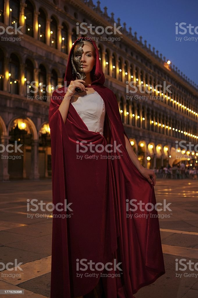 Woman with a mask on San Marco square stock photo