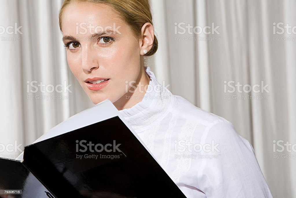 Woman with a menu stock photo
