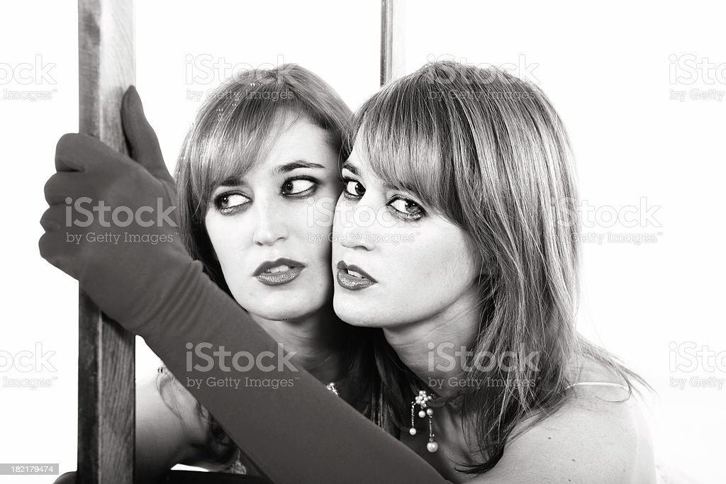 Woman with a mirror, bw stock photo
