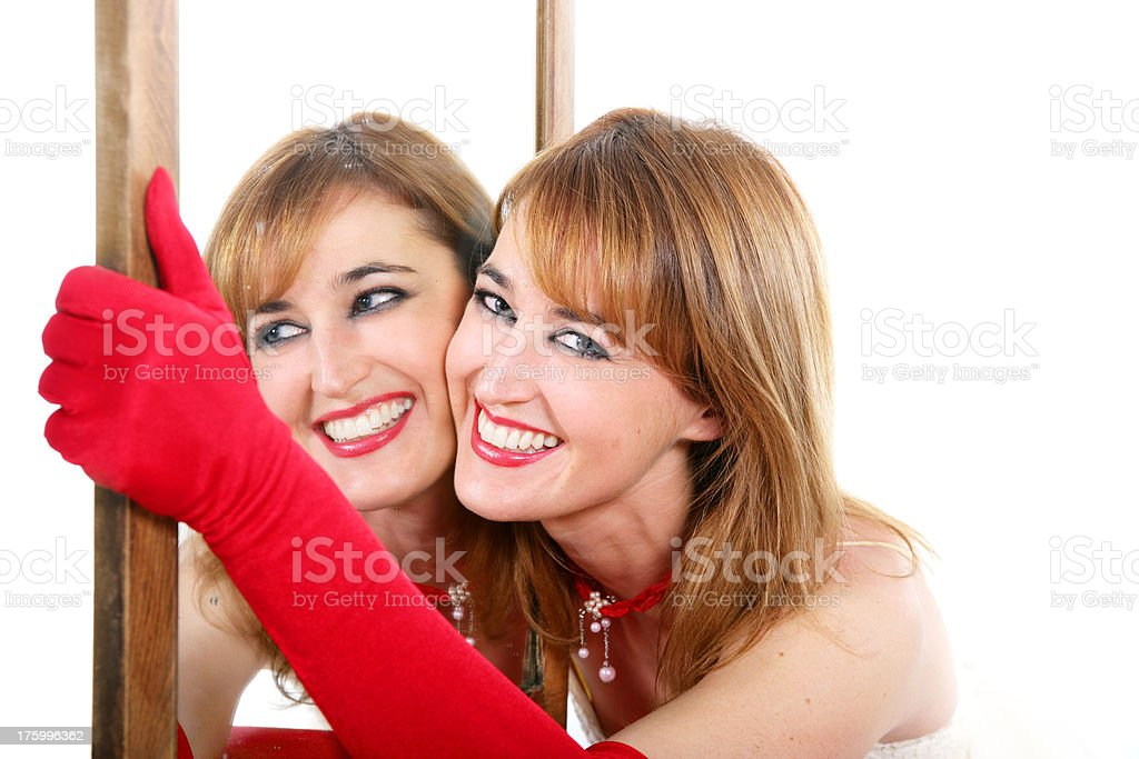 Woman with a mirror, smiling stock photo