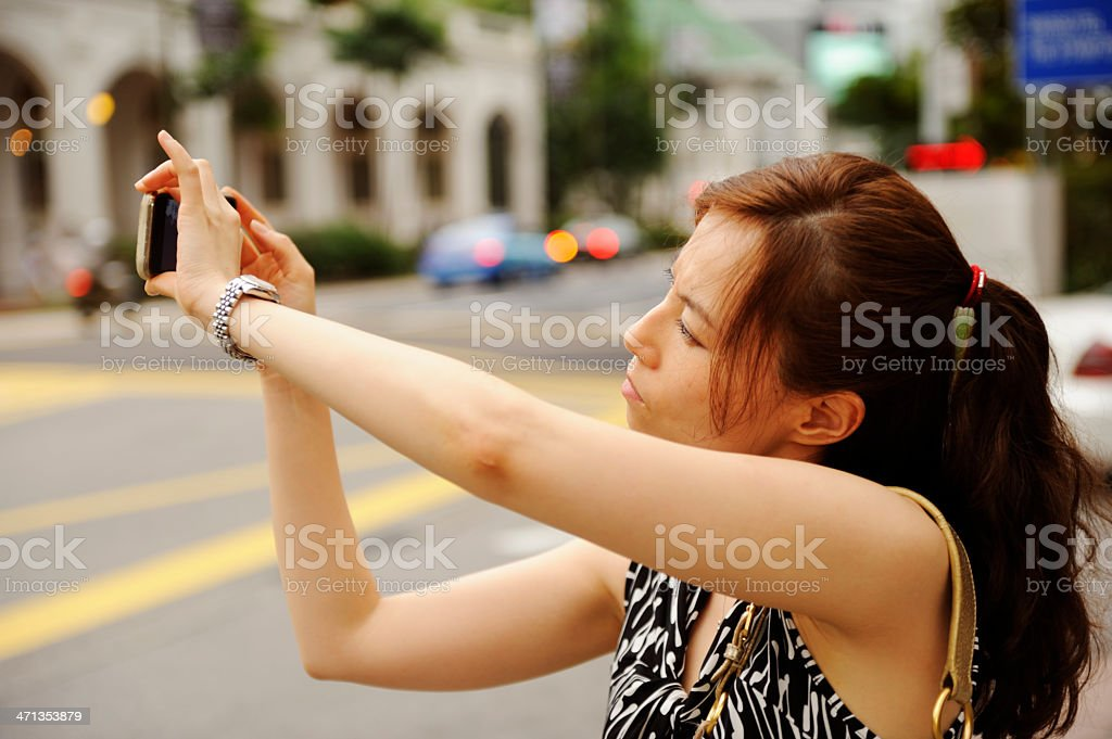 Woman with a mobile phone camera royalty-free stock photo