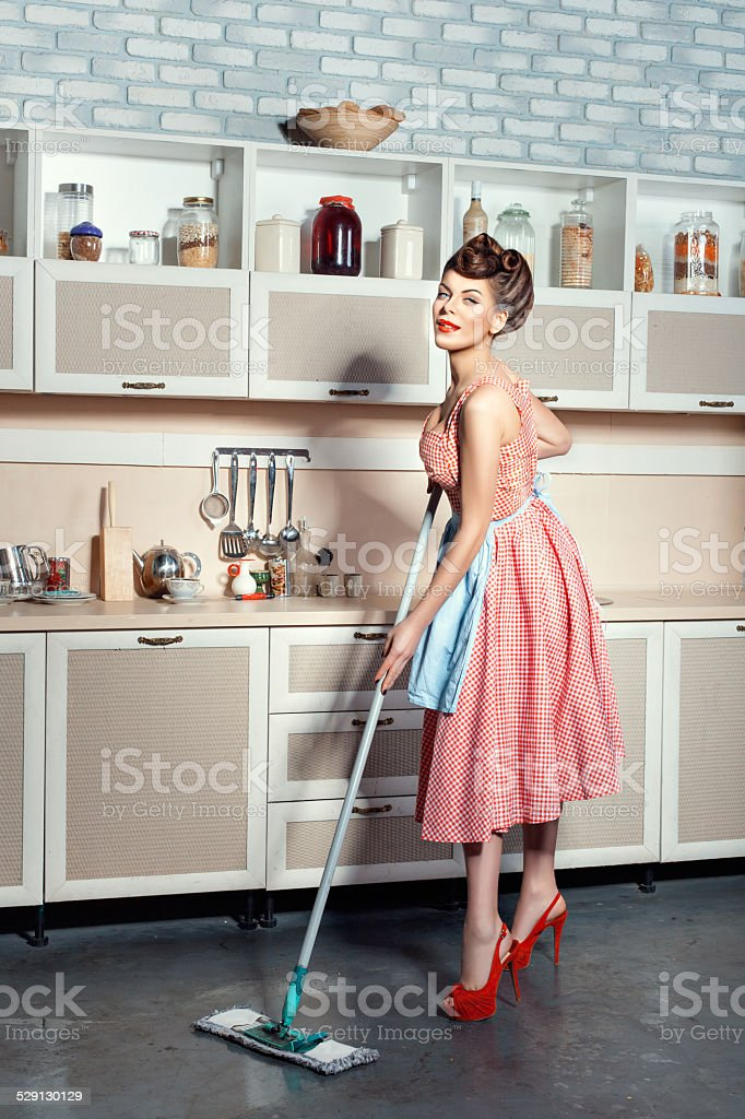 Woman with a mop. stock photo