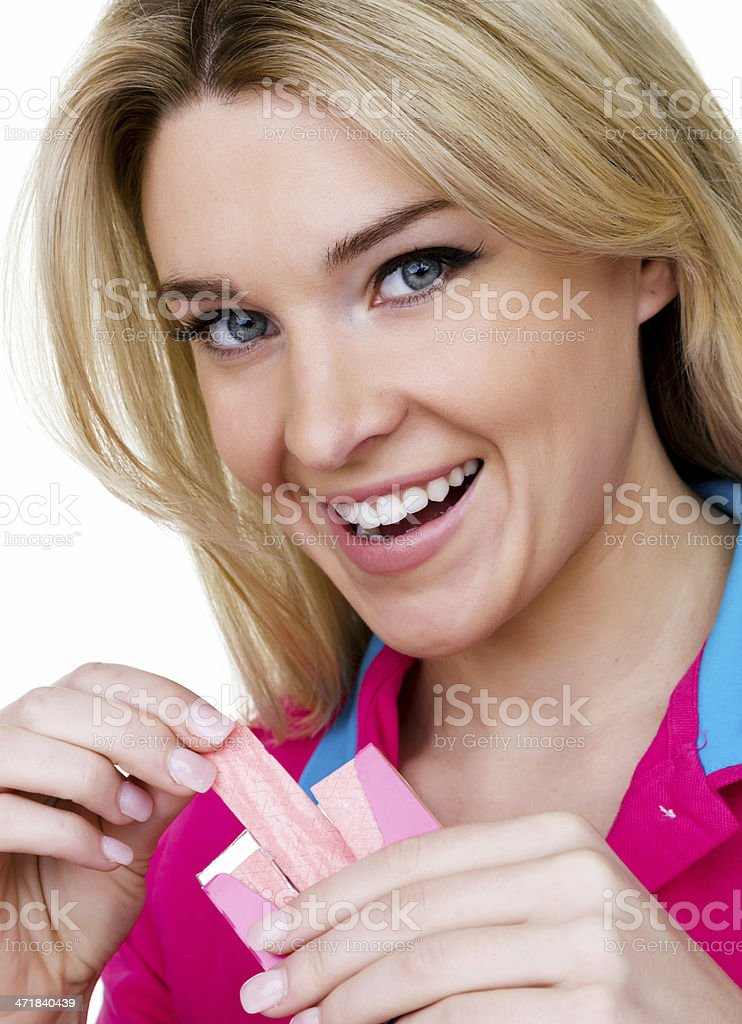 Woman with a pack of chewing gum royalty-free stock photo