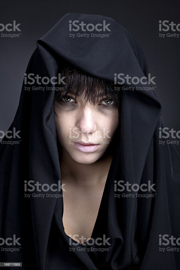 Woman with a pale face in black stock photo