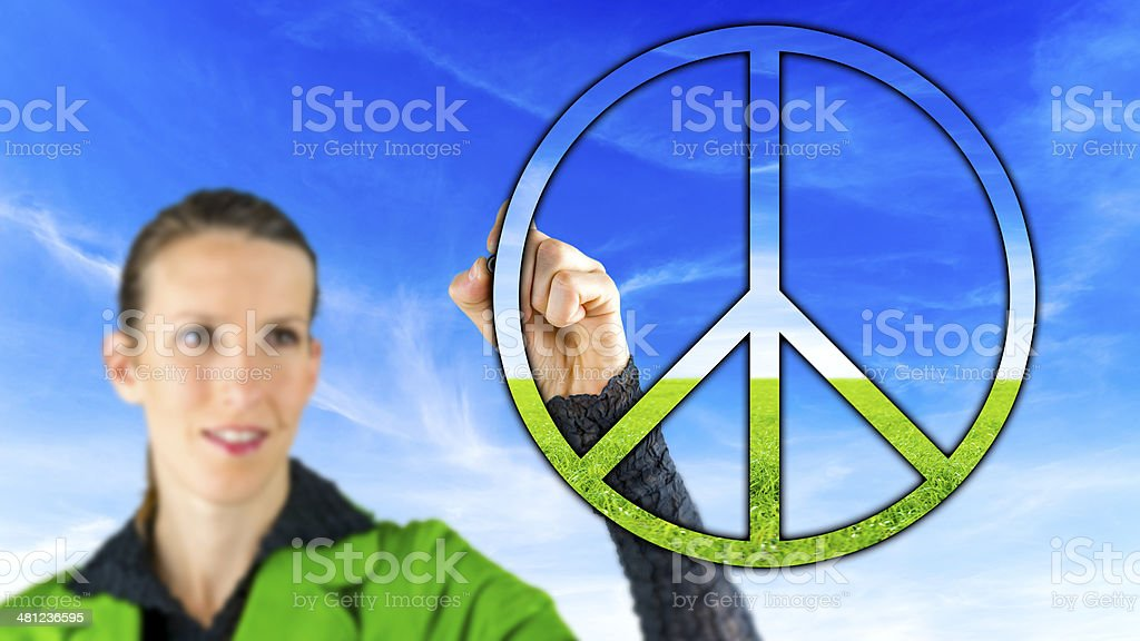 Woman with a peace sign stock photo