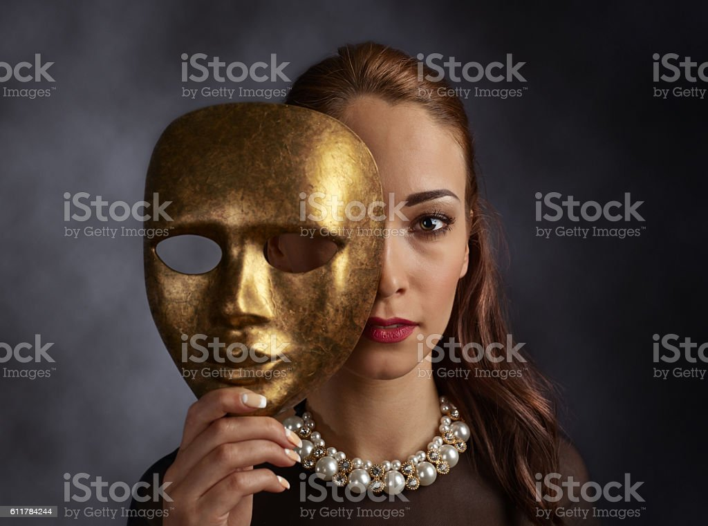 woman with a pearl necklace and old mask stock photo