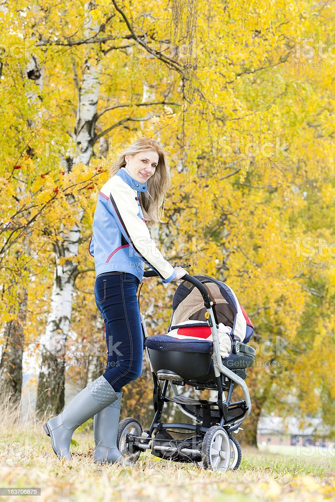 woman with a pram royalty-free stock photo