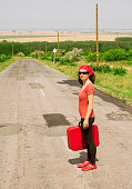 Woman with a red suitcase