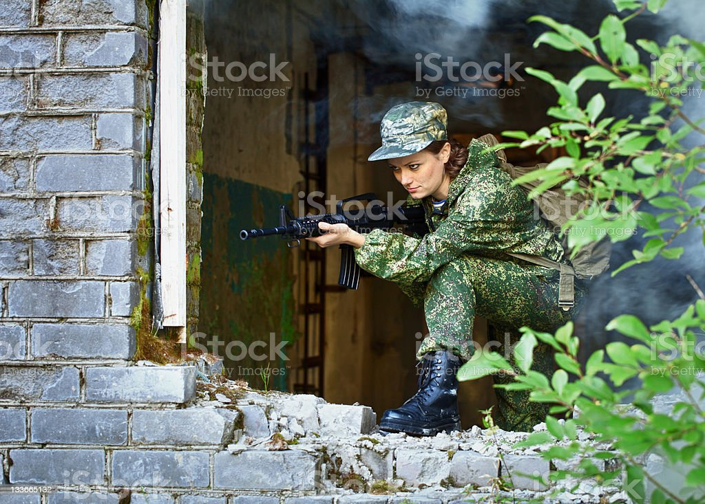 Woman with a rifle, keep defense in the battle royalty-free stock photo