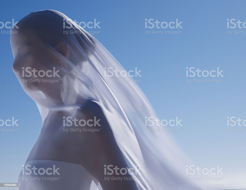 Woman with a sheer sheet royalty-free stock photo