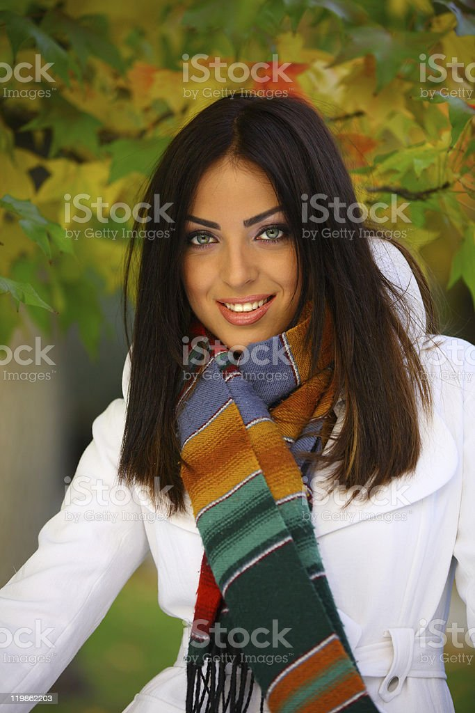 Woman with a smile in Autumn stock photo