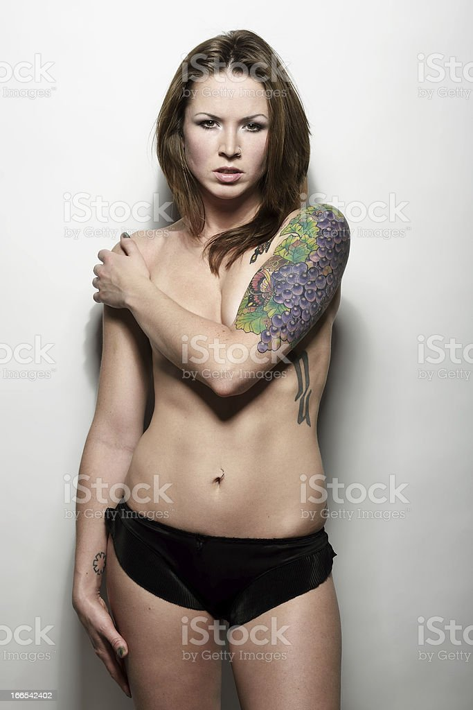 Woman with a tattoo on her arm royalty-free stock photo