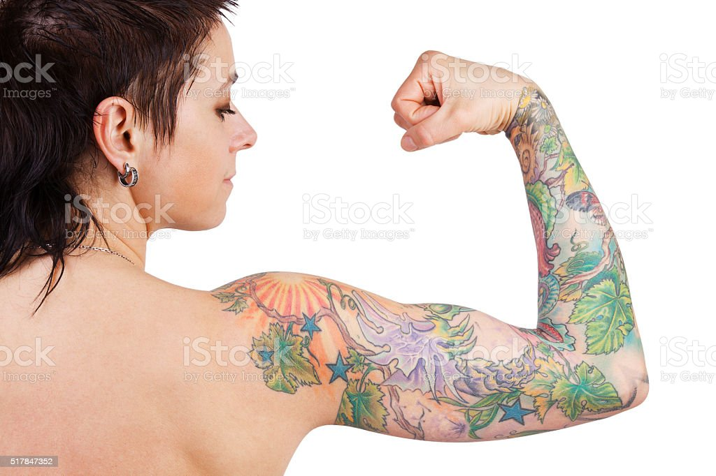 Woman with a tattoo showing biceps stock photo