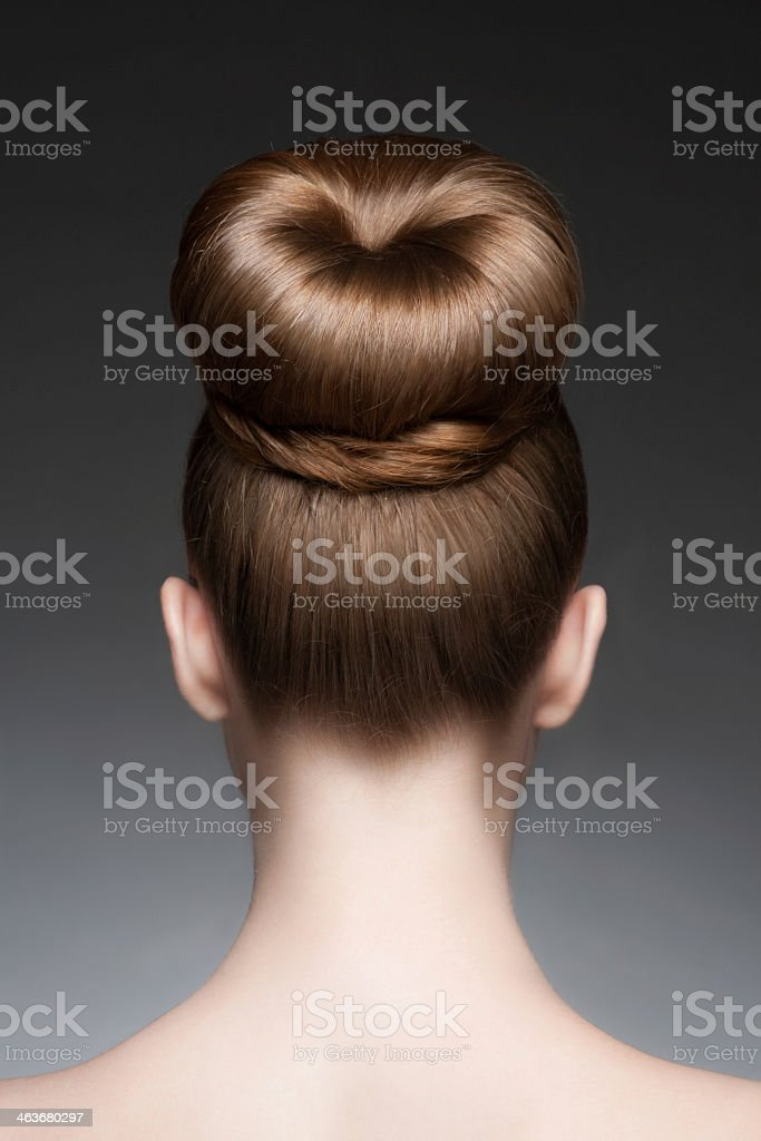 Woman with a thick elegant bun stock photo