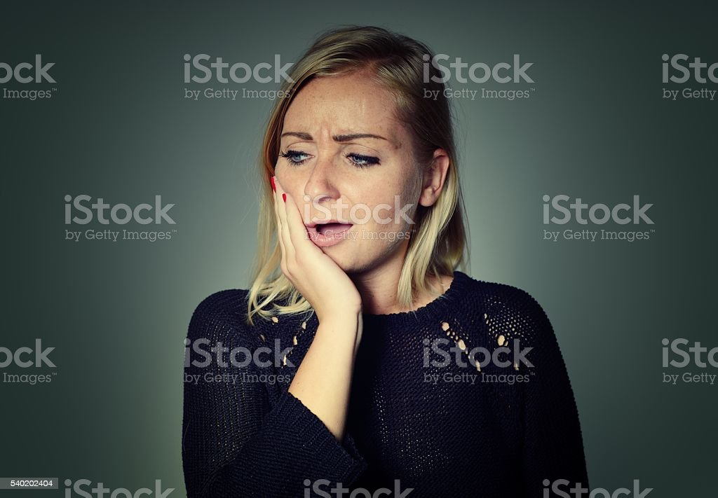 Woman with a toothache. stock photo