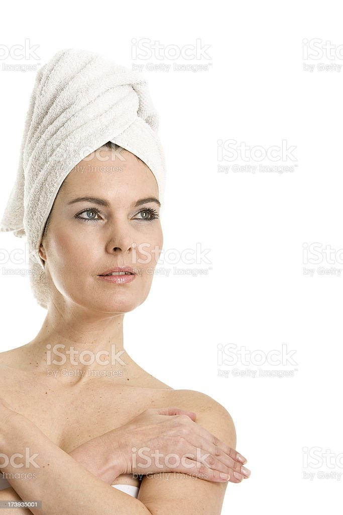 Woman with a towel around her head stock photo