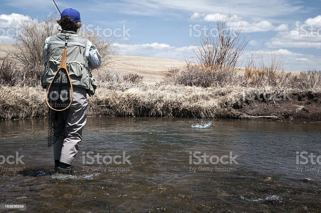 Woman with a Trout on the Line stock photo