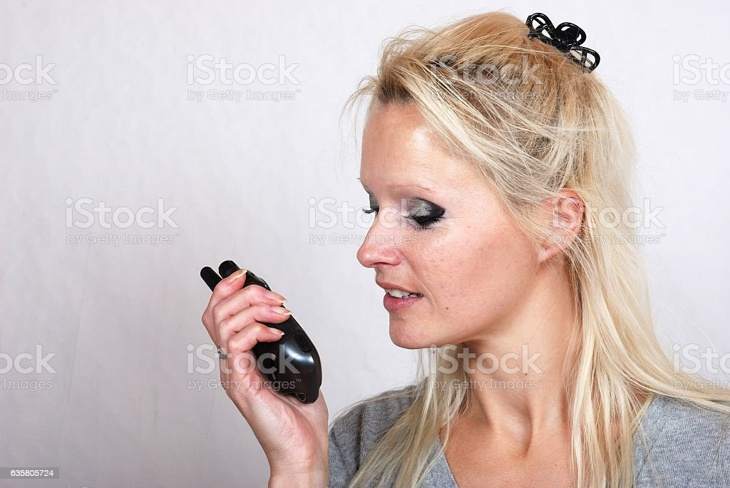 Woman with a walkie-talkie stock photo
