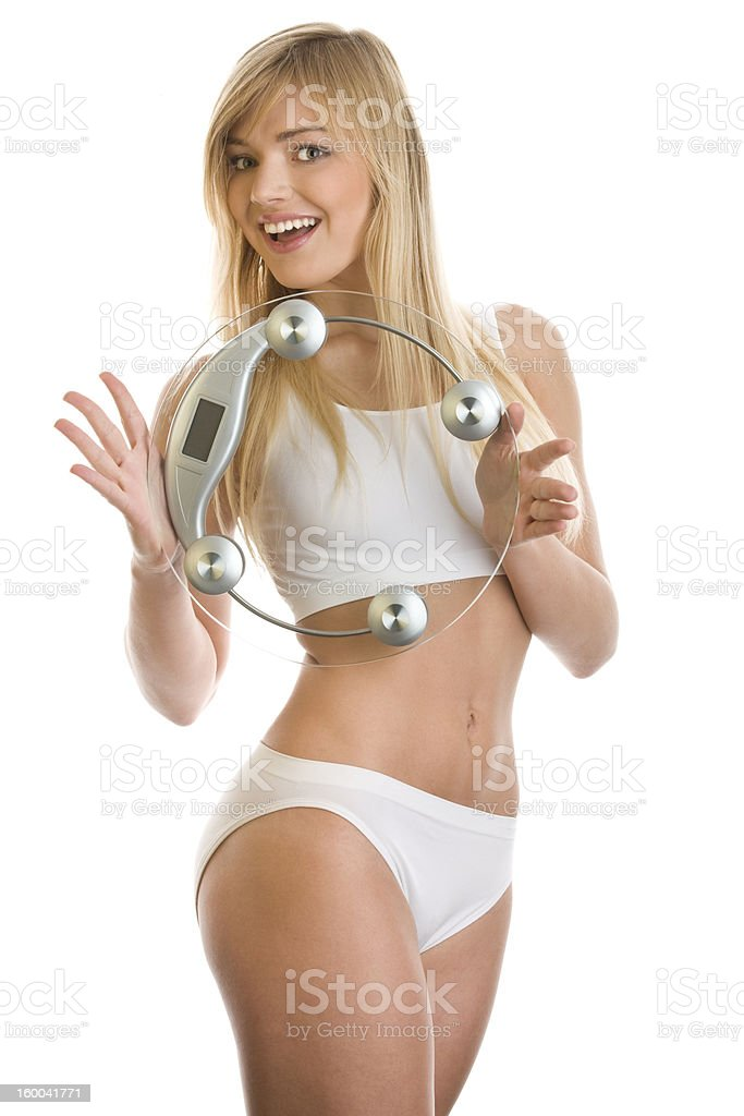Woman with a weight scale royalty-free stock photo