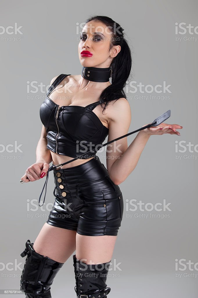woman with a whip stock photo