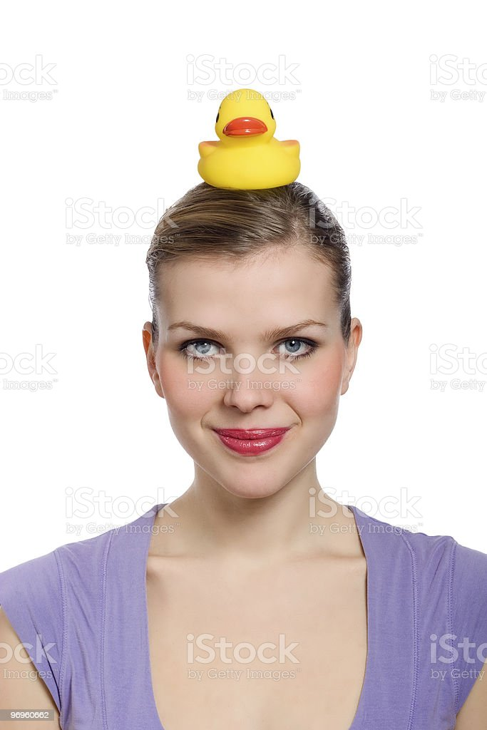 woman with a yellow rubber duck on her head royalty-free stock photo