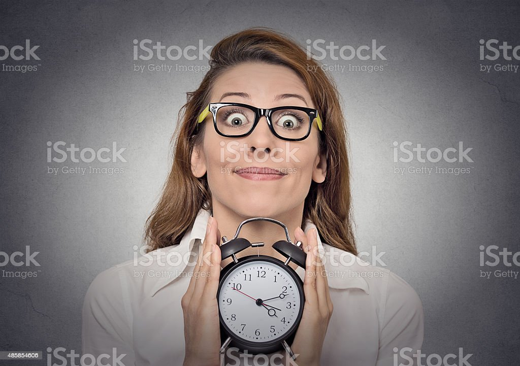woman with alam clock stock photo