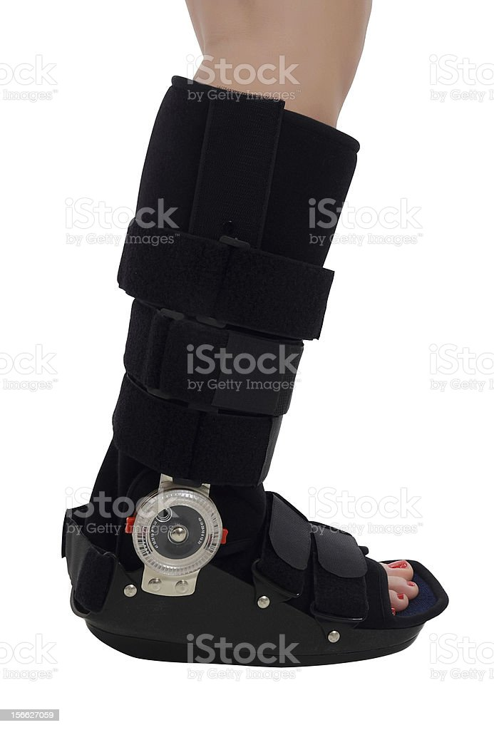 Woman with an ankke brace royalty-free stock photo