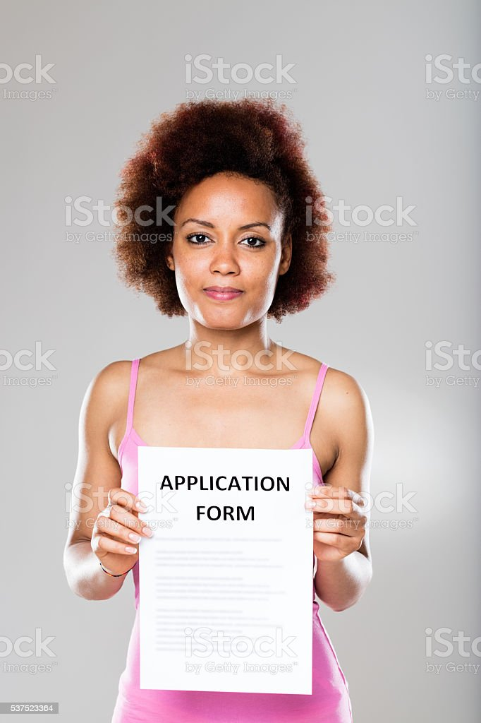 woman with an application form stock photo
