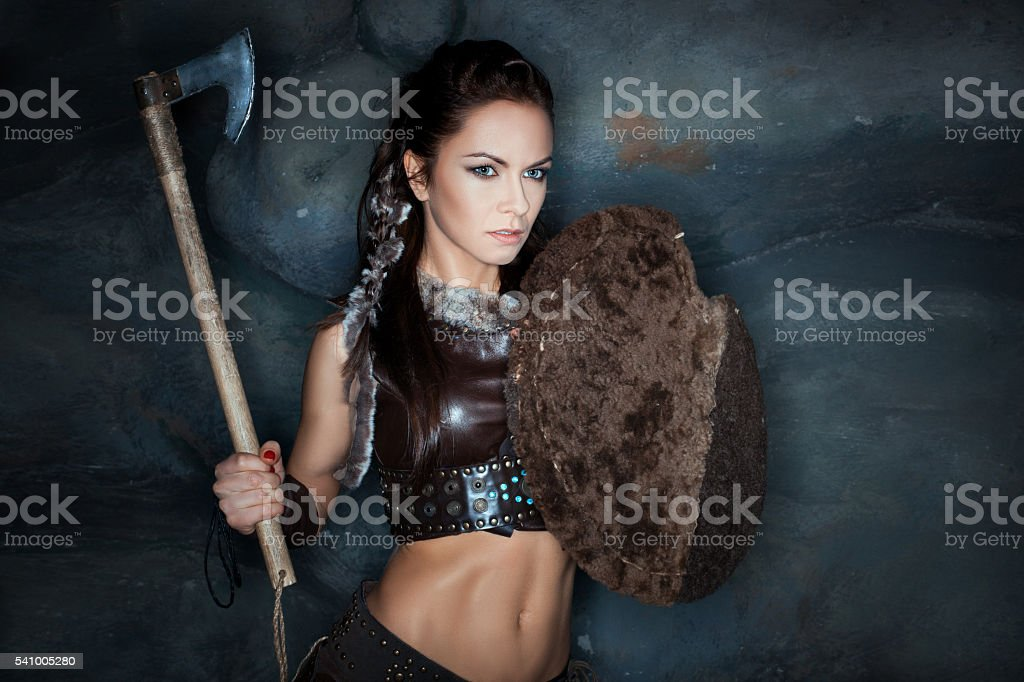 Woman with an ax in his hand. stock photo