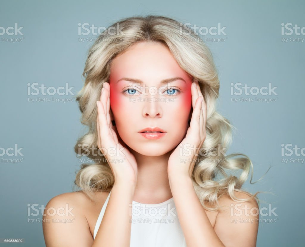 Woman with an Headache. Woman Puts Hands on the Head. Medicine Concept stock photo