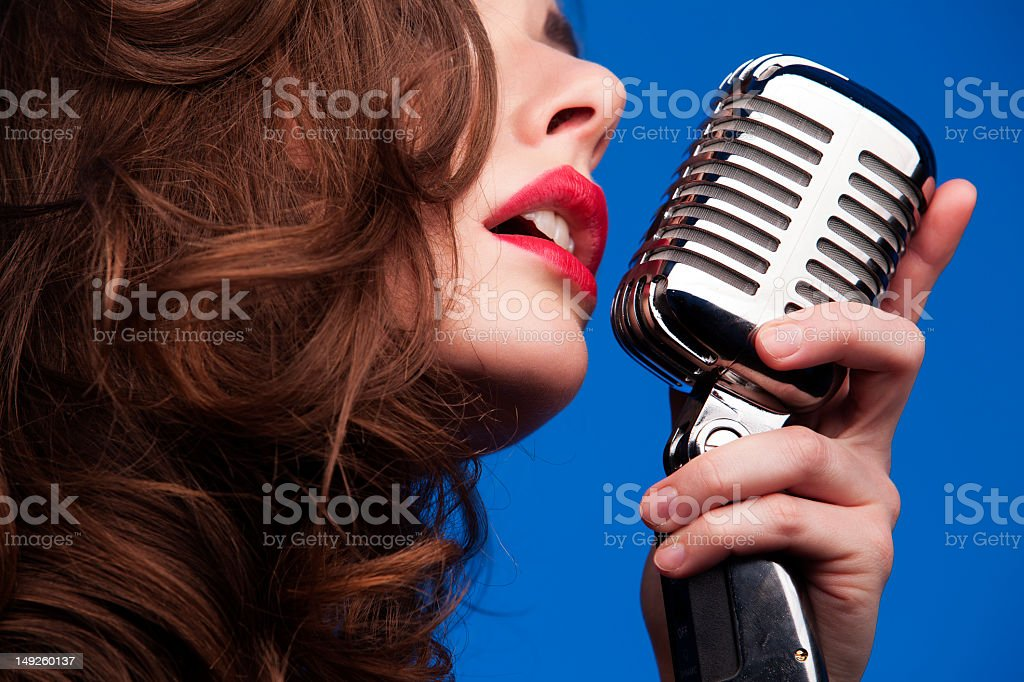Woman with an old fashioned microphone stock photo