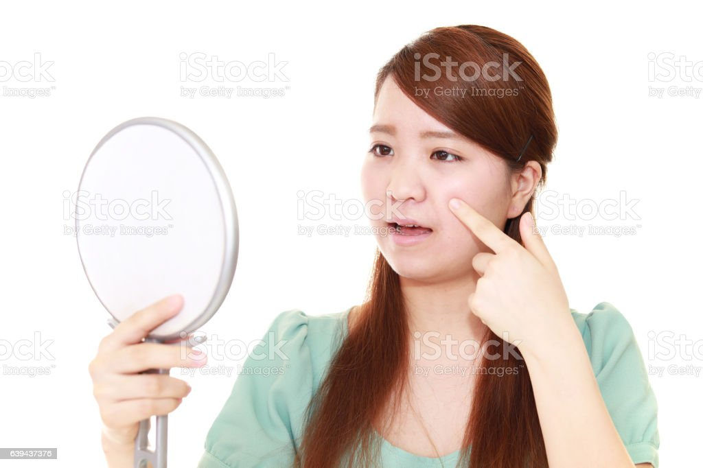 Woman with an uneasy look stock photo