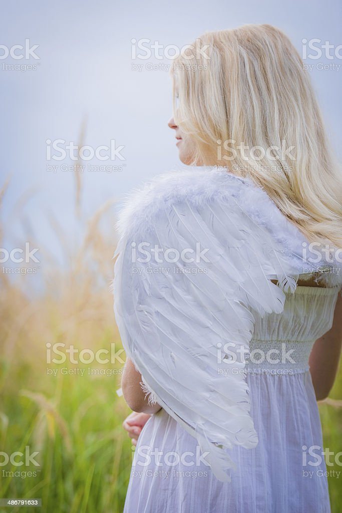 Woman with angel wings on back stock photo