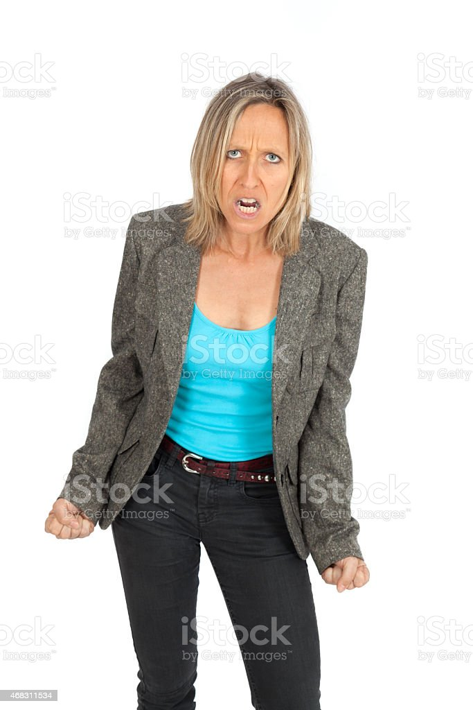 Woman with angry expression and fists clenched on white back stock photo