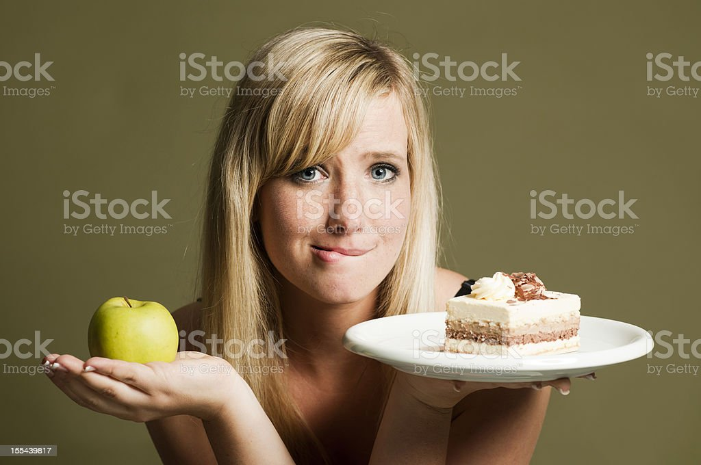 Woman with apple and cake royalty-free stock photo