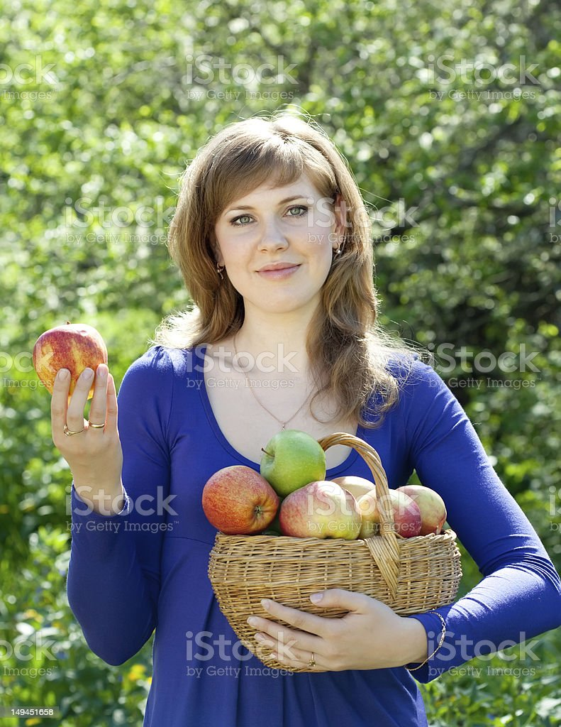 woman with apple harvest in orchard royalty-free stock photo