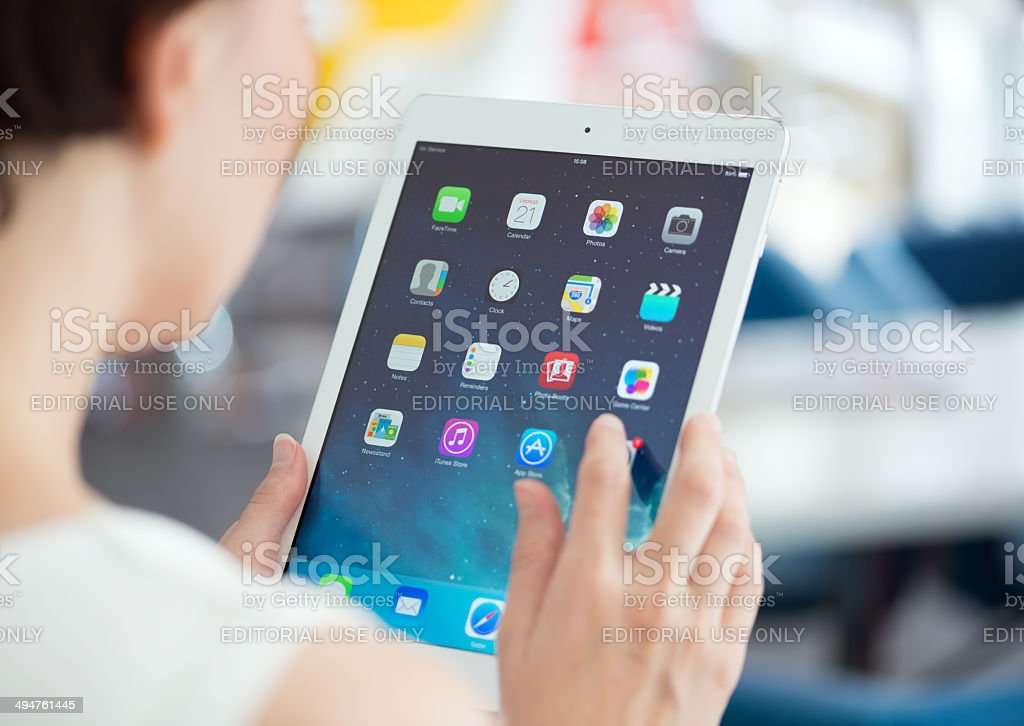 Woman with Apple iPad Air stock photo