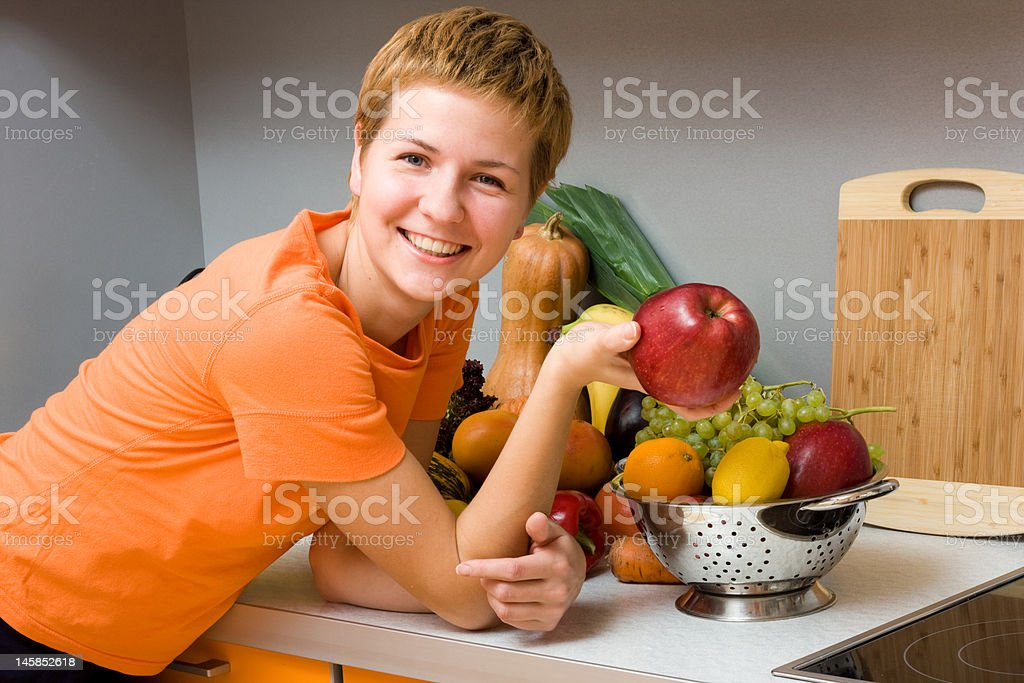 Woman with apple royalty-free stock photo