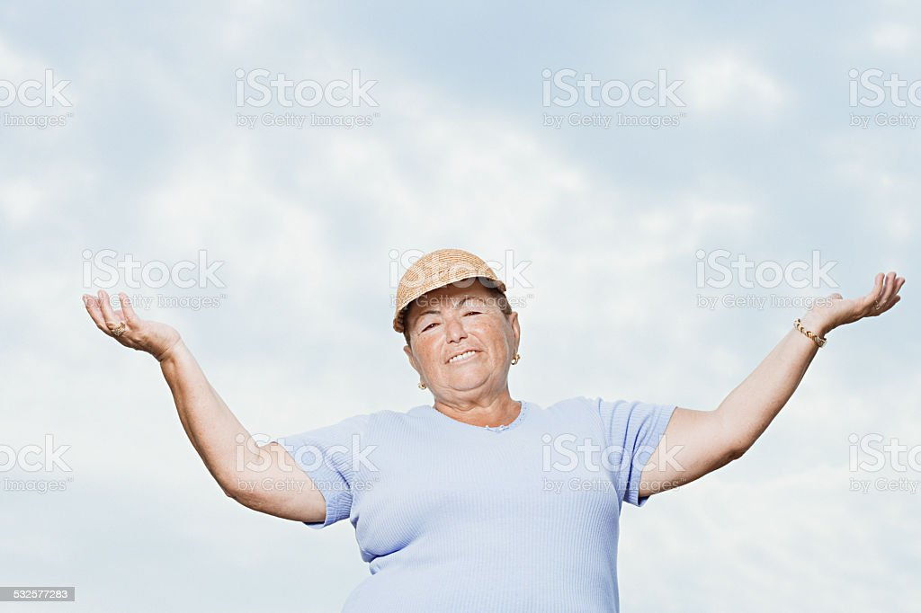Woman with arms open stock photo