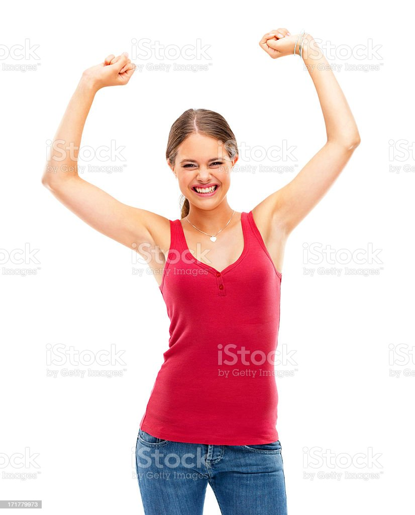 Woman with arms raised against white background stock photo