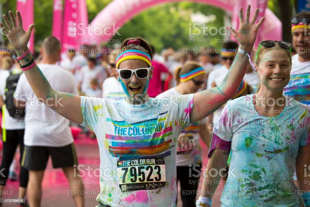 Woman with arms raised celebrating, The Color Run Event Seattle stock photo