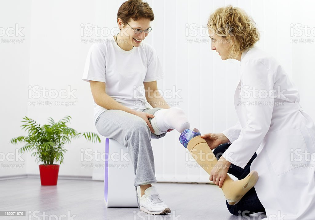 Woman with Artificial Limb at doctors office stock photo