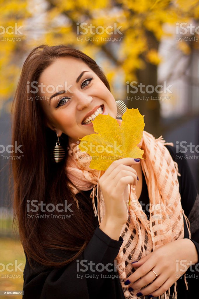 Woman with autumn maple leafe stock photo