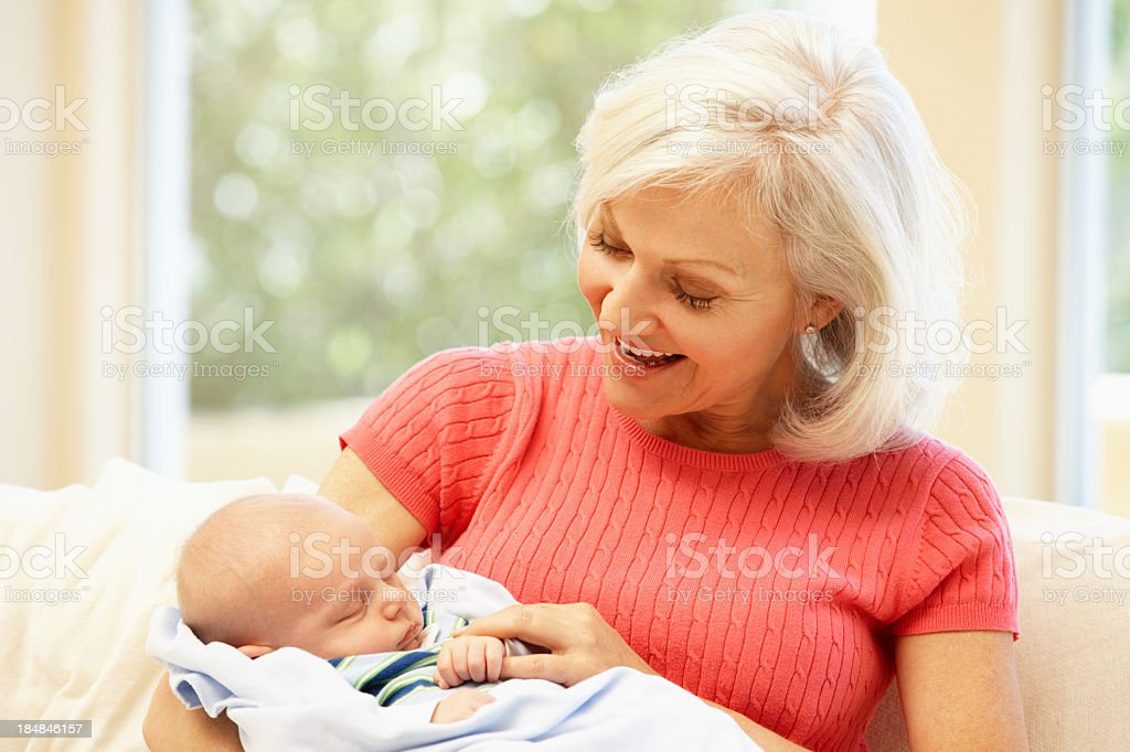 Woman with baby grandson stock photo
