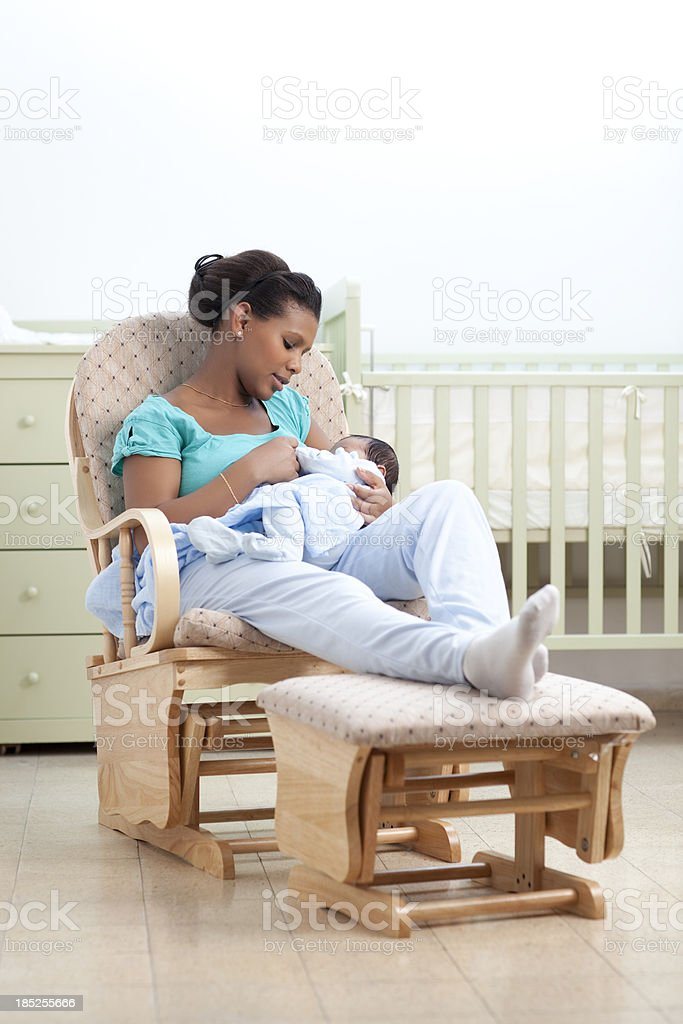 Woman with baby in a rocking chair. royalty-free stock photo