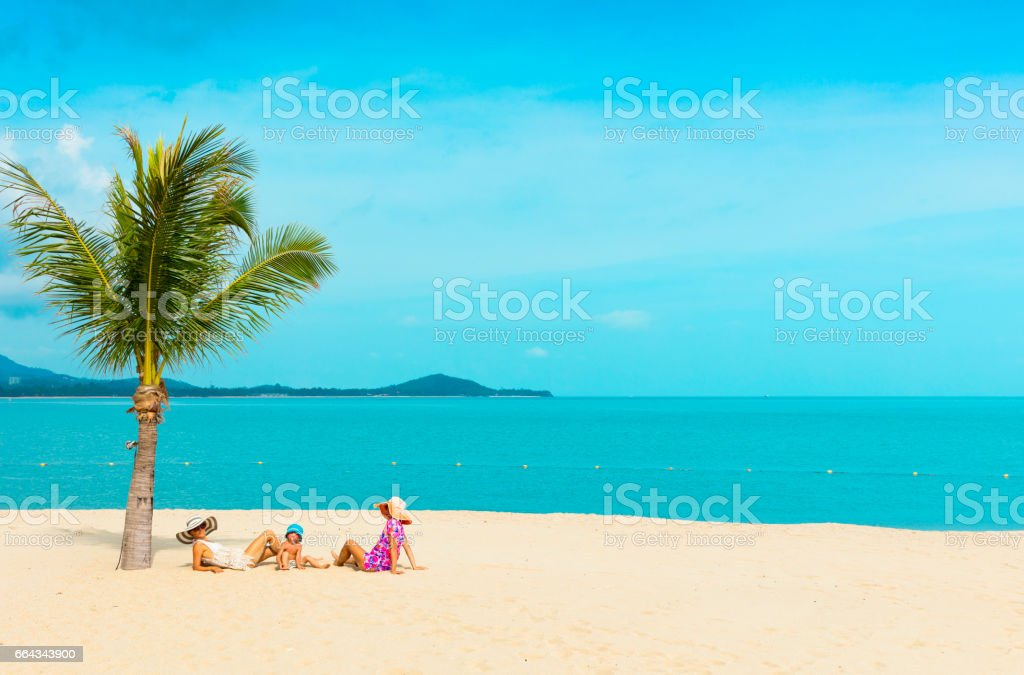 Woman with baby on the beach stock photo