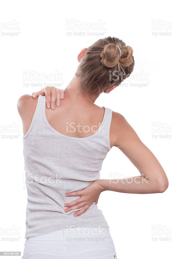 Woman with back pain, isolated on white background stock photo