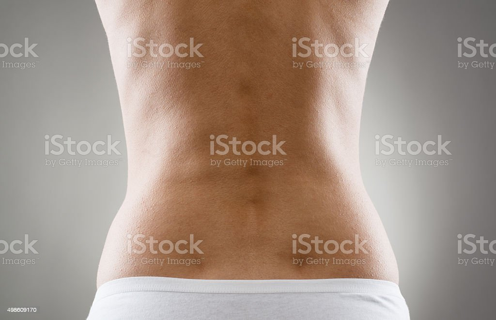 Woman with back pain stock photo